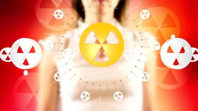 Young female pressing the screen then nuclear symbol appearing video