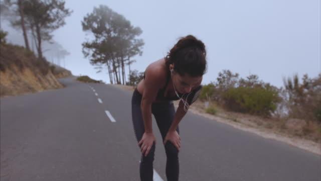 Young female runner taking break video