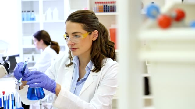 Young female scientist works in research laboratory video