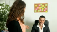 Young female secretary flirting with her boss video