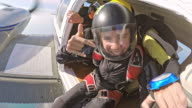 POV Young female skydiver waiting to jump off the plane video
