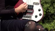 Young Female Strumming Electric Guitar video