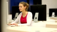 Young female student working in a computer classroom video