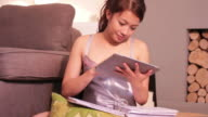 Young female studying at home video