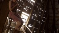 Young female swinging in a barn video