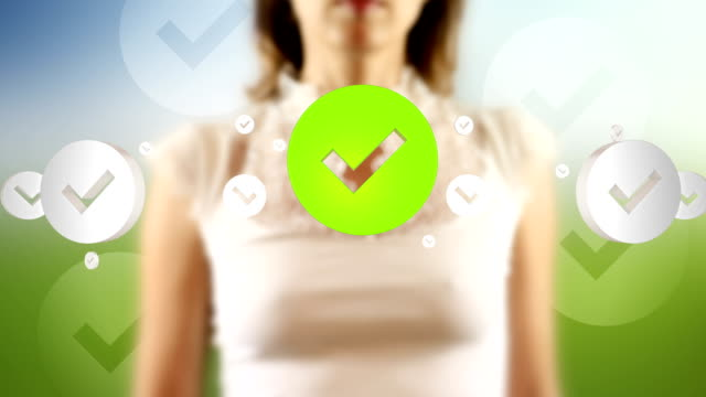 Young Female Touching On Screen Check Mark Symbols Appears video
