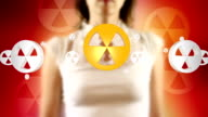 Young Female Touching On Screen Nuclear Symbols Appears video