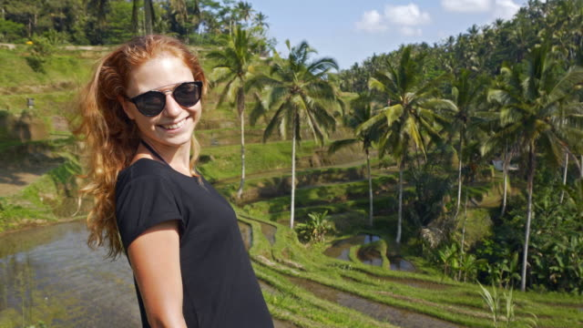 Young female tourist admiring Tegalalang Rice Terrace in Bali video