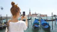 Young Woman Taking Pictures of Venice, Italy video