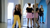 Young females are preparing for fashion show in model school video
