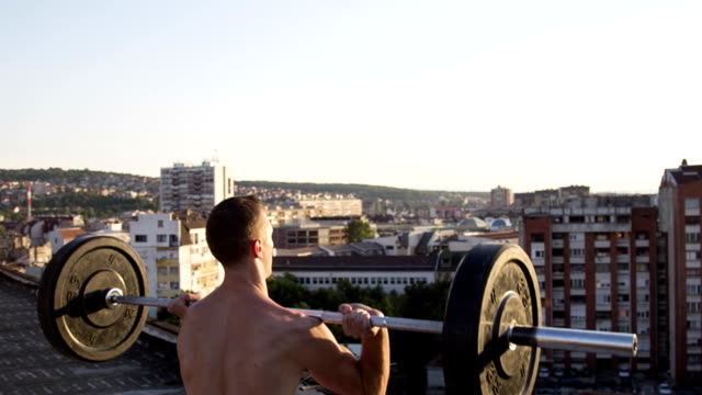 Young fit athlete man doing Push Press video