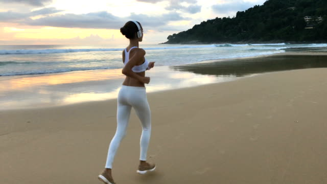 Young Fit Girl In Sportswear Running On Beach video