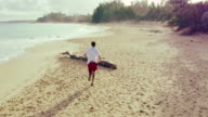 4K Young Fit Male Running on Beach. Aerial Fly By. Outdoor Healthy Lifestyle. video