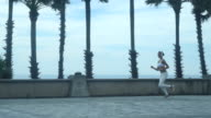 Young Fitness Woman Runner Running On Seaside video