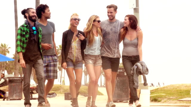 SLOW MOTION - Young Friends Fun Group at Venice Beach, Los Angeles. video