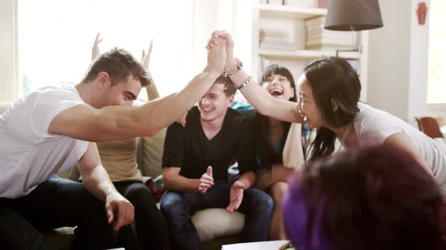 Young friends get together for a party video