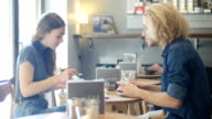 Young friends having coffee in coffee shop video