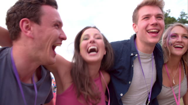 Young friends having fun at a music festival video