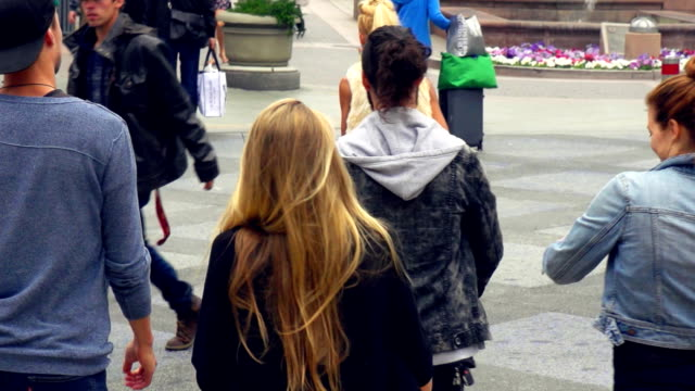 SLOW MOTION - Young Friends Having Fun on Santa Monica Street, Los Angeles. video