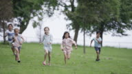 Young Friends Jogging through Park video