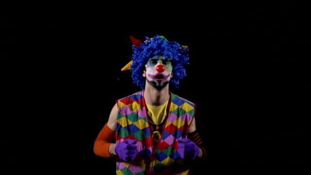 Young funny clown shouting and using a megaphone video