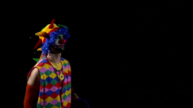 Young funny clown using a megaphone and shouting video