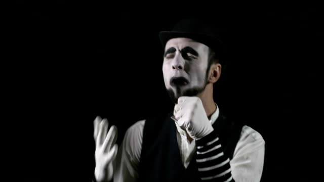 Young funny singing mime singing and being deafened by a megaphone video