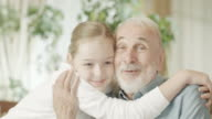 Young girl and grandfather video
