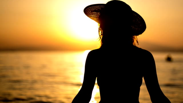 Young girl at sunset video