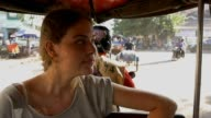 Young girl backpacker traveling alone on tuk tuk in asia video