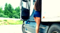 Young girl check lorry truck and walk out video