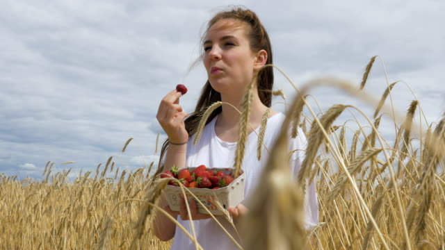 Young Girl Delights in Eating Strawberries video