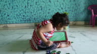Young girl drawing on slate video