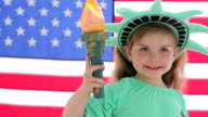 Young girl dressed up like statue of liberty video