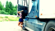 Young girl exit from truck and repair video