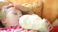 Young Girl Falling Asleep On Sofa video
