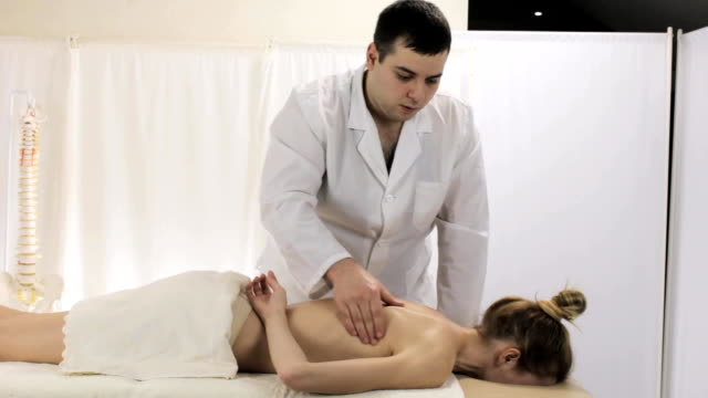 Young girl gets a healing massage in the salon video