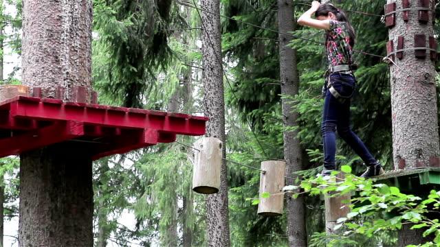 Young girl having fun in a climbing adventure video