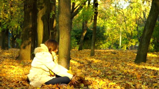 Young Girl Having Fun Throwing Yellow Leaves. video