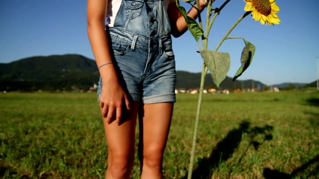 Young girl holding a sunflower video