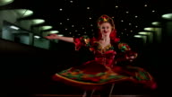 Young girl in a red dress dancing folk dance. video