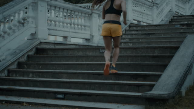 Young Girl is Climbing Stairs during Morning Run. video