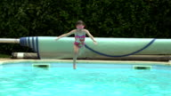 Young Girl Jumping Into Outdoor Pool In Slow Motion video