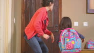 Young girl leaves for school video