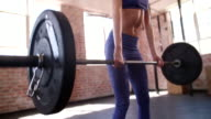Young girl lifting weights during gym training at the gym video