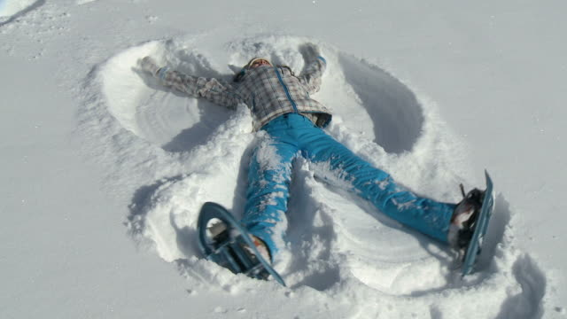 HD: Young girl making a snow angel. video