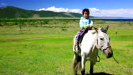 Young girl on horseback in Mongolian landscape video