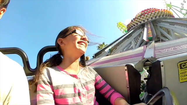 Young Girl on Spinning Fair Ride in Slow Motion video