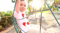 Young girl on swing, slow motion. video