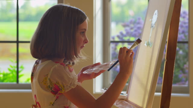 Young girl painting video